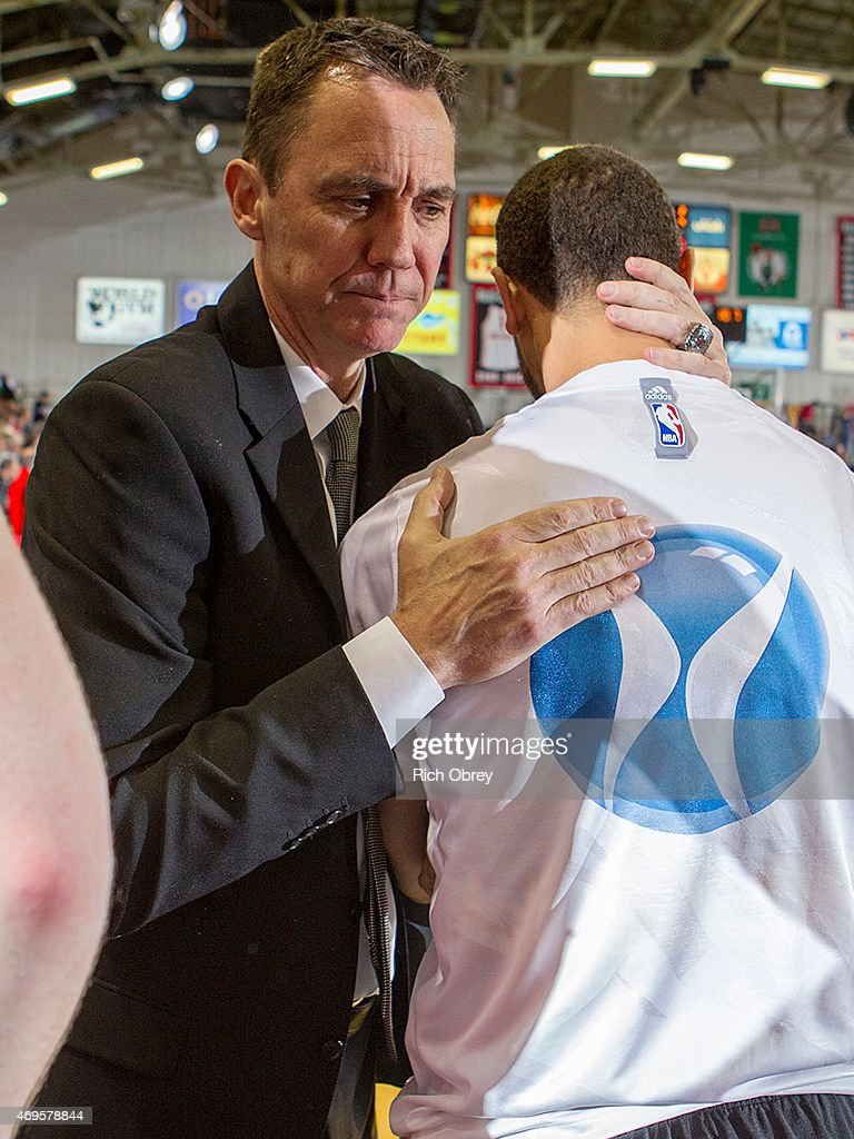 Head Coach Conner Henry of the Fort Wayne Mad Ants congratulates Trey McKinney-Jones #12 at the conclusion of Playoff Game #2 against the Maine Red Claws on April 11, 2015 at the Portland Expo.