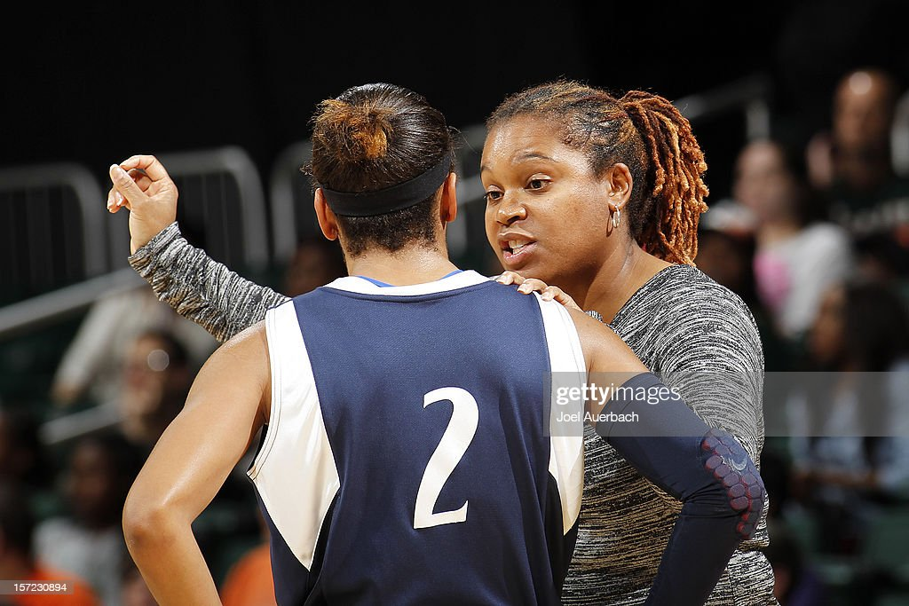Head coach Coquese Washington talks to Dara Taylor #2 of the Penn State Lady Lions during a break in action against the Miami Hurricanes on November 29, 2012 at the BankUnited Center in Coral Gables, Florida. Miami defeated Penn State 69-65.