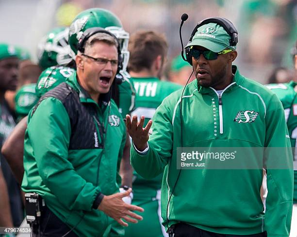 Head coach Corey Chamblin and offensive coordinator Jacques Chapdelaine of the Saskatchewan Roughriders express frustration on the sideline in the...