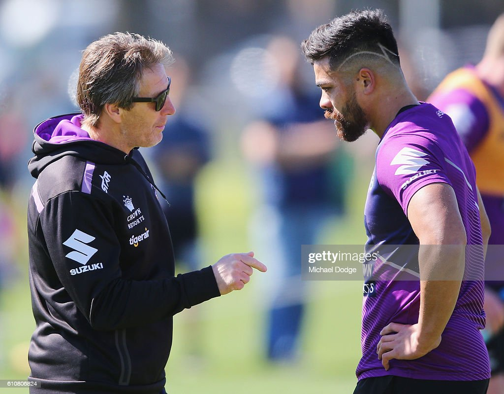 Head coach Craig Bellamy speaks to Young Tonumalpea of the Storm during a Melbourne Storm NRL training session at AAMI Park on September 28, 2016 in Melbourne, Australia.