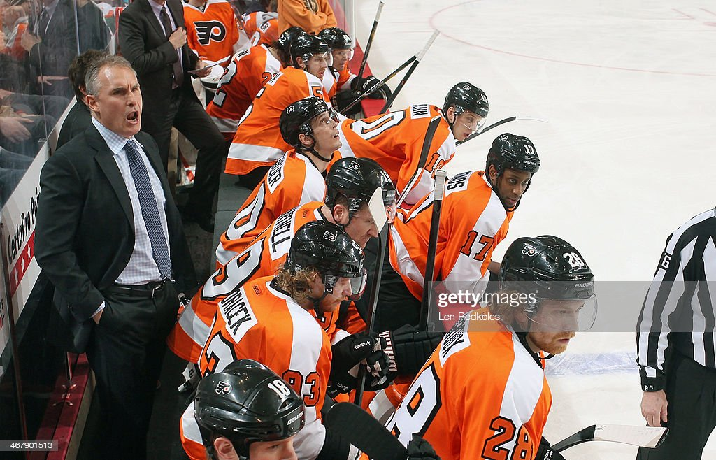 Head Coach <a gi-track='captionPersonalityLinkClicked' href=/galleries/search?phrase=Craig+Berube&family=editorial&specificpeople=2271925 ng-click='$event.stopPropagation()'>Craig Berube</a> of the Philadelphia Flyers appears upset with a call on the ice during his game against the Calgary Flames on February 8, 2014 at the Wells Fargo Center in Philadelphia, Pennsylvania.