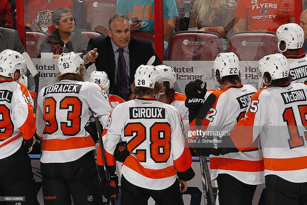 Head Coach Craig Berube of the Philadelphia Flyers directs his team from the bench against the Florida Panthers at the BB&T Center on April 8, 2014 in Sunrise, Florida.