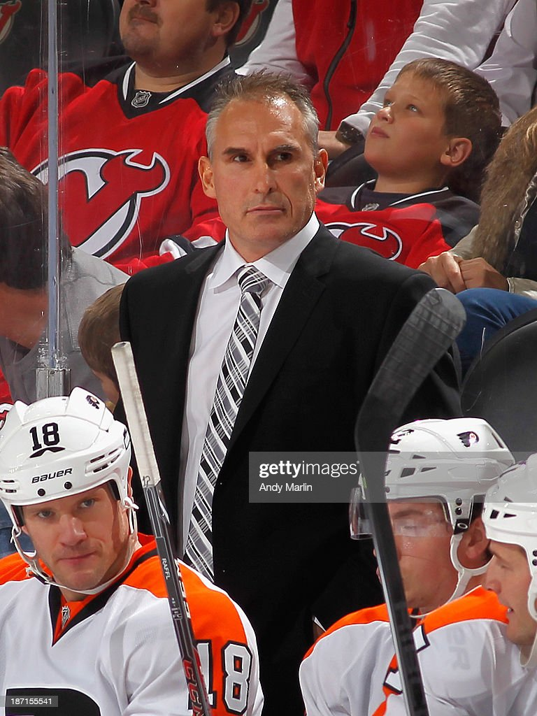 Head coach Craig Berube of the Philadelphia Flyers looks on during the game against the New Jersey Devils at the Prudential Center on November 2, 2013 in Newark, New Jersey.