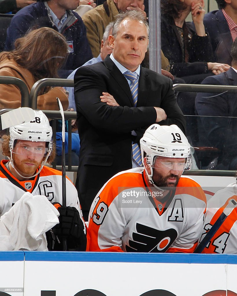 Head coach Craig Berube of the Philadelphia Flyers looks on from the bench against the New York Rangers in Game One of the First Round of the 2014 Stanley Cup Playoffs at Madison Square Garden on April 17, 2014 in New York City.