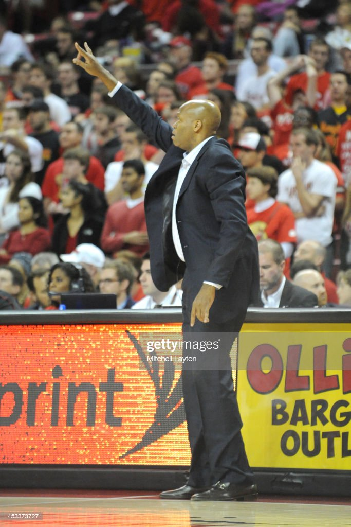 Head coach Craig Robinson of the Oregon State Beavers signals to his players during a college basketball game against the Maryland Terrapins on...
