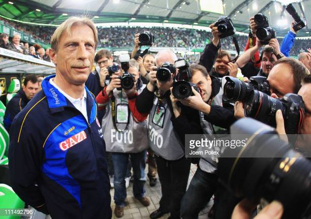 Head coach Cristoph Daum of Frankfurt is sourrounded by photographer prior to the Bundesliga match between VfL Wolfsburg and Eintracht Frankfurt at...