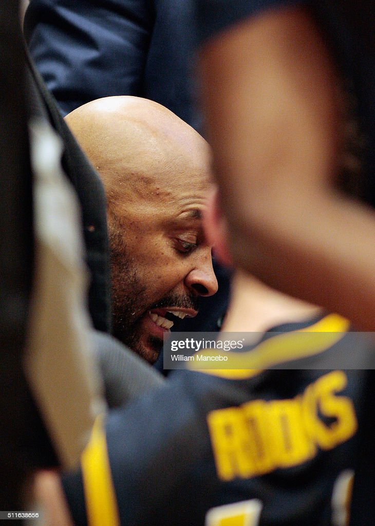 Head coach <a gi-track='captionPersonalityLinkClicked' href=/galleries/search?phrase=Cuonzo+Martin&family=editorial&specificpeople=3911162 ng-click='$event.stopPropagation()'>Cuonzo Martin</a> of the California Golden Bears huddles with his players during a timeout in the second half against the Washington State Cougars at Beasley Coliseum on February 21, 2016 in Pullman, Washington. California defeated Washington State 80-62.