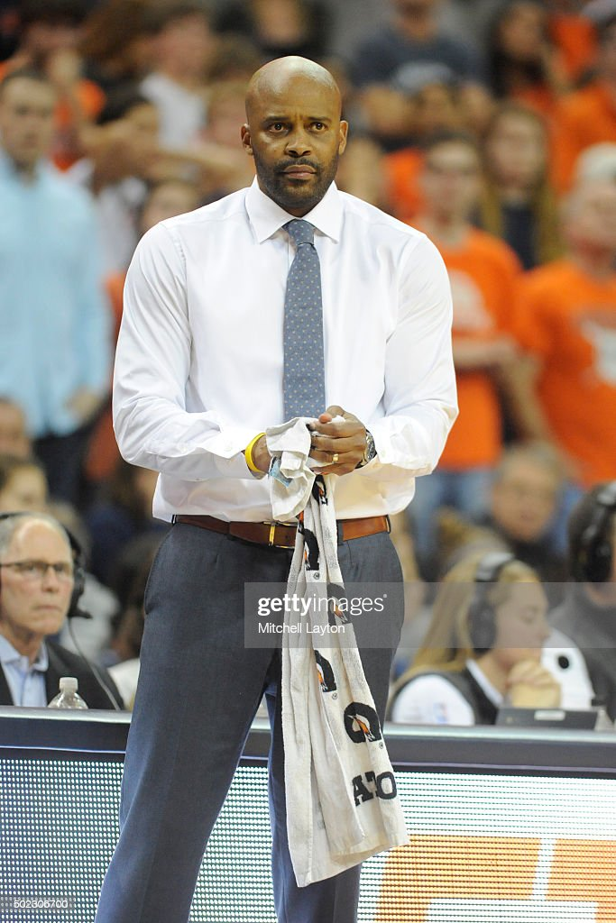Head coach <a gi-track='captionPersonalityLinkClicked' href=/galleries/search?phrase=Cuonzo+Martin&family=editorial&specificpeople=3911162 ng-click='$event.stopPropagation()'>Cuonzo Martin</a> of the California Golden Bears looks on during a college basketball game against the Virginia Cavaliers at John Paul Jones Arena on December 22, 2015 in Charlottesville, Virginia .