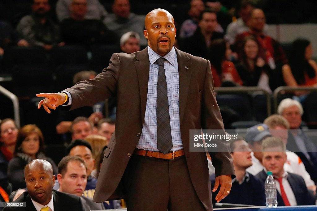 Head coach <a gi-track='captionPersonalityLinkClicked' href=/galleries/search?phrase=Cuonzo+Martin&family=editorial&specificpeople=3911162 ng-click='$event.stopPropagation()'>Cuonzo Martin</a> of the California Golden Bears looks on from the bench against the Texas Longhorns at Madison Square Garden on November 21, 2014 in New York City.