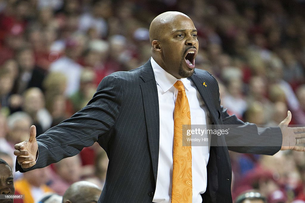 Head Coach Cuonzo Martin of the Tennessee Volunteers yells to his team during a game against the Arkansas Razorbacks at Bud Walton Arena on February 2, 2013 in Fayetteville, Arkansas. The Razorbacks defeated the Volunteers 73-60.
