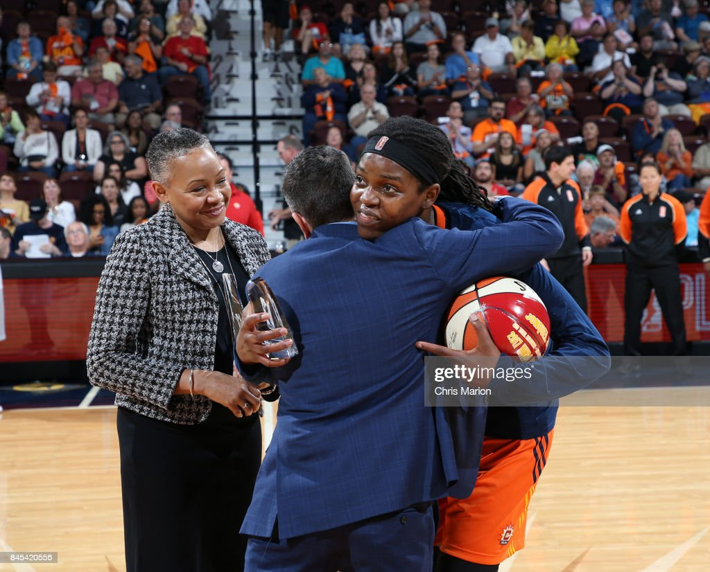 Head Coach Curt Miller hugs Jonquel Jones #35 of the Connecticut Sun who receives a trophy for the 2017 WNBA Most Improved Player during the game against the Phoenix Mercury in Round Two of the 2017 WNBA Playoffs on September 10, 2017 at Mohegan Sun Arena in Uncasville, CT.