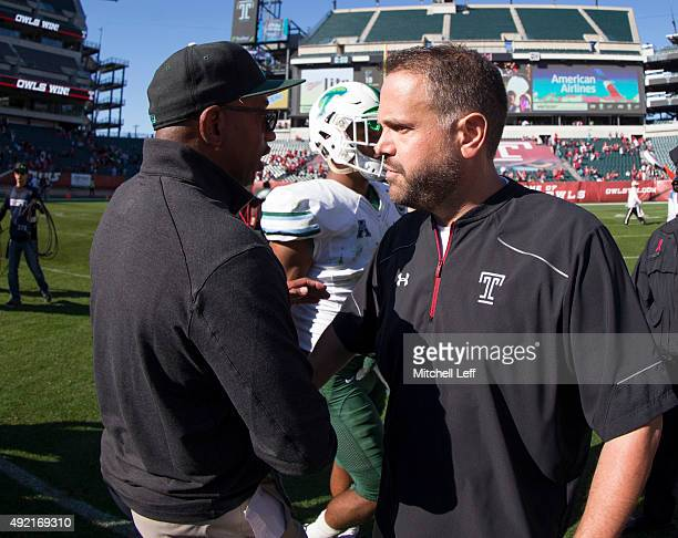 Head coach Curtis Johnson of the Tulane Green Wave shakes hands with head coach Matt Rhule of the Temple Owls after the game on October 10 2015 at...