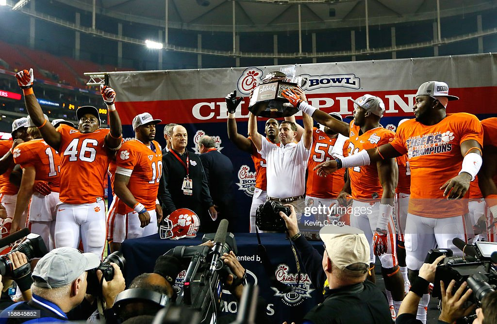 Head coach Dabo Swinney and his Clemson Tigers celebrate their 25-24 win over the LSU Tigers during the 2012 Chick-fil-A Bowl at Georgia Dome on December 31, 2012 in Atlanta, Georgia.