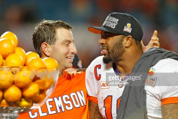 Head coach Dabo Swinney and Tajh Boyd of the Clemson Tigers celebrate their victory against the Ohio State Buckeyes after the 2014 Discover Orange...