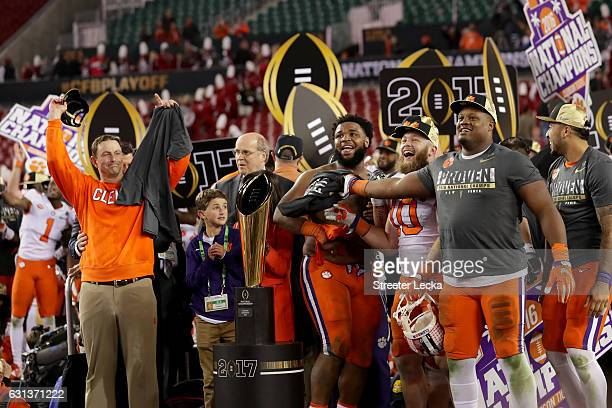 Head coach Dabo Swinney of the Clemson Tigers and defensive tackle Christian Wilkins react after defeating the Alabama Crimson Tide 3531 to win the...