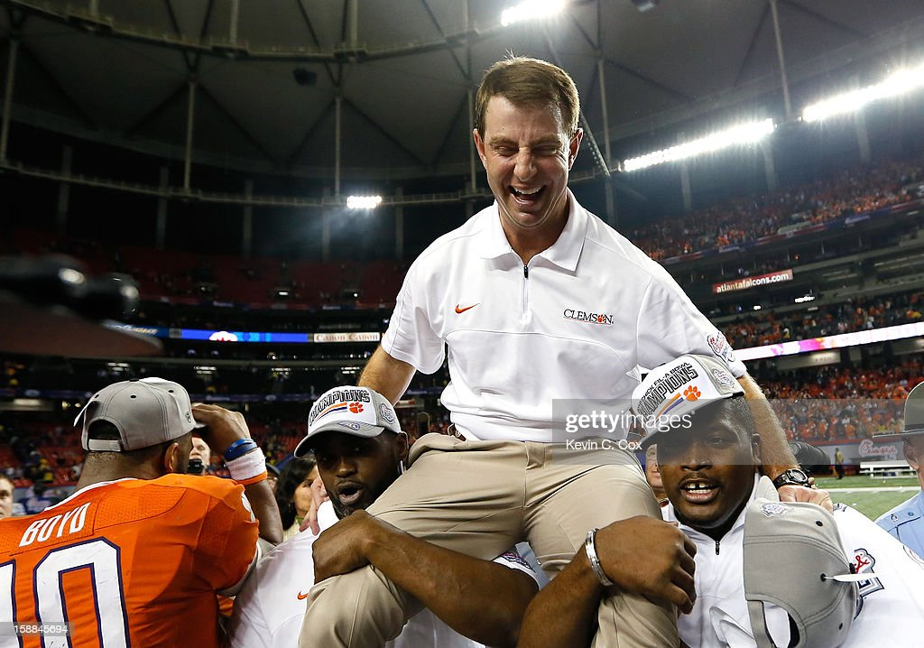 Head coach Dabo Swinney of the Clemson Tigers celebrates their 25-24 win over the LSU Tigers during the 2012 Chick-fil-A Bowl at Georgia Dome on December 31, 2012 in Atlanta, Georgia.