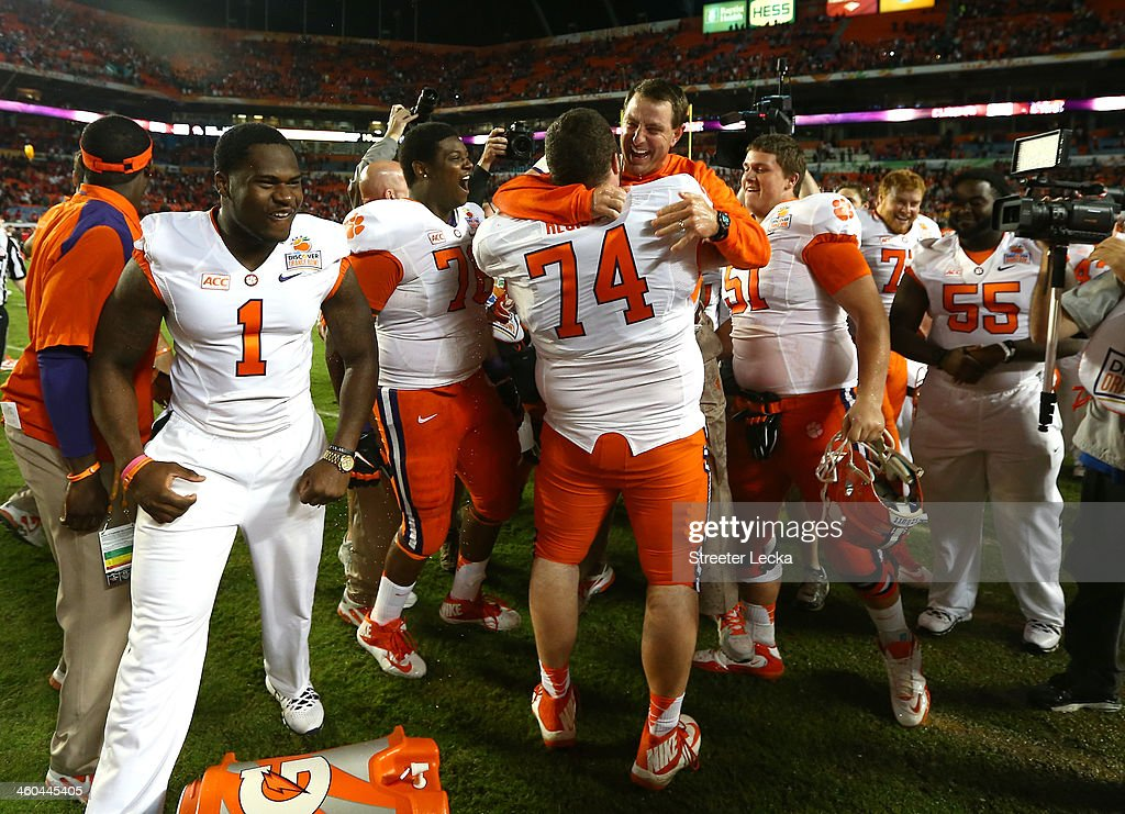 Head coach Dabo Swinney of the Clemson Tigers celebrates with his team late in the game against the Ohio State Buckeyes during the Discover Orange Bowl at Sun Life Stadium on January 3, 2014 in Miami Gardens, Florida. Clemson defeated Ohio State 40-35.