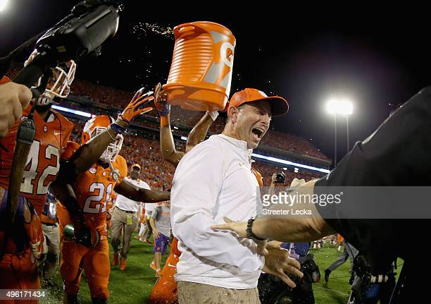 Head coach Dabo Swinney of the Clemson Tigers celebrates with his team after defeating the Florida State Seminoles 2313 at Memorial Stadium on...