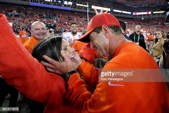 Head coach Dabo Swinney of the Clemson Tigers celebrates with his wife Kathleen Swinney after defeating the Alabama Crimson Tide 3531 to win the 2017...