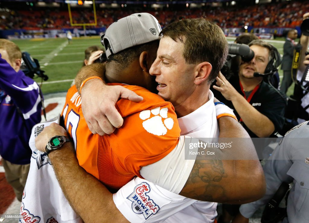 Head coach Dabo Swinney of the Clemson Tigers celebrates with <a gi-track='captionPersonalityLinkClicked' href=/galleries/search?phrase=Tajh+Boyd&family=editorial&specificpeople=7352415 ng-click='$event.stopPropagation()'>Tajh Boyd</a> #10 after their 25-24 win over the LSU Tigers during the 2012 Chick-fil-A Bowl at Georgia Dome on December 31, 2012 in Atlanta, Georgia.