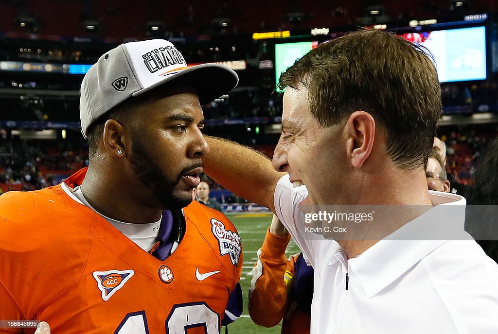 Head coach Dabo Swinney of the Clemson Tigers celebrates with Tajh Boyd #10 after their 25-24 win over the LSU Tigers during the 2012 Chick-fil-A Bowl at Georgia Dome on December 31, 2012 in Atlanta, Georgia.
