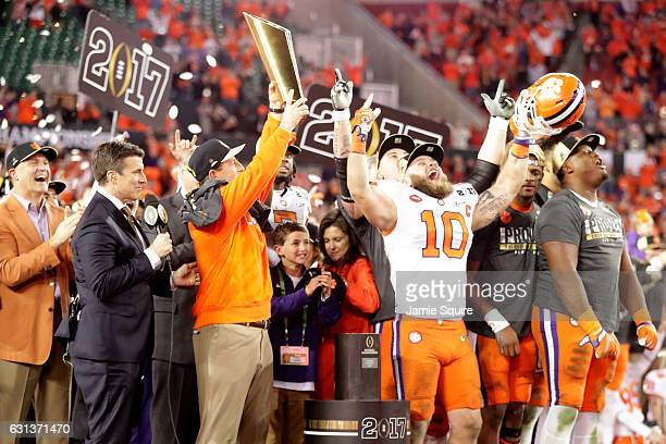 Head coach Dabo Swinney of the Clemson Tigers celebrates with the College Football Playoff National Championship Trophy after defeating the Alabama...