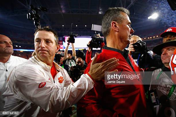 Head coach Dabo Swinney of the Clemson Tigers greets head coach Urban Meyer of the Ohio State Buckeyes after the Clemson Tigers beat the Ohio State...