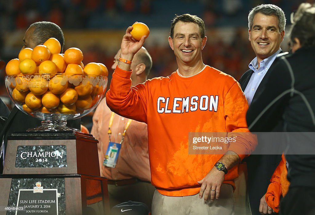 Head coach Dabo Swinney of the Clemson Tigers holds up an orange after defeating the Ohio State Buckeyes during the Discover Orange Bowl at Sun Life Stadium on January 3, 2014 in Miami Gardens, Florida. Clemson defeated Ohio State 40-35.