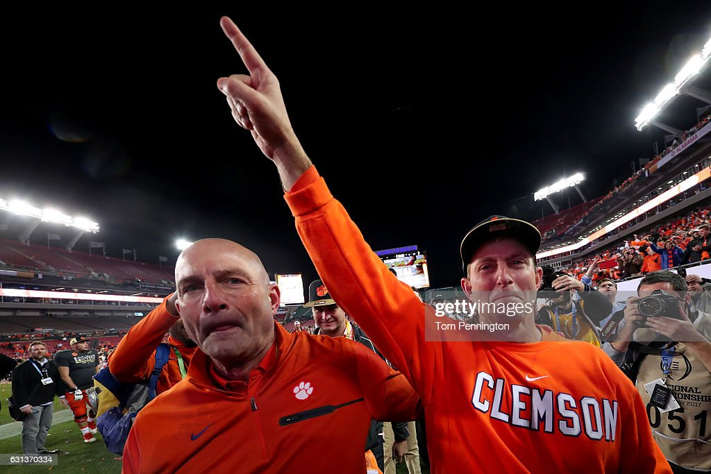 Head coach Dabo Swinney of the Clemson Tigers (R) reacts after defeating the Alabama Crimson Tide 35-31 to win the 2017 College Football Playoff National Championship Game at Raymond James Stadium on January 9, 2017 in Tampa, Florida.