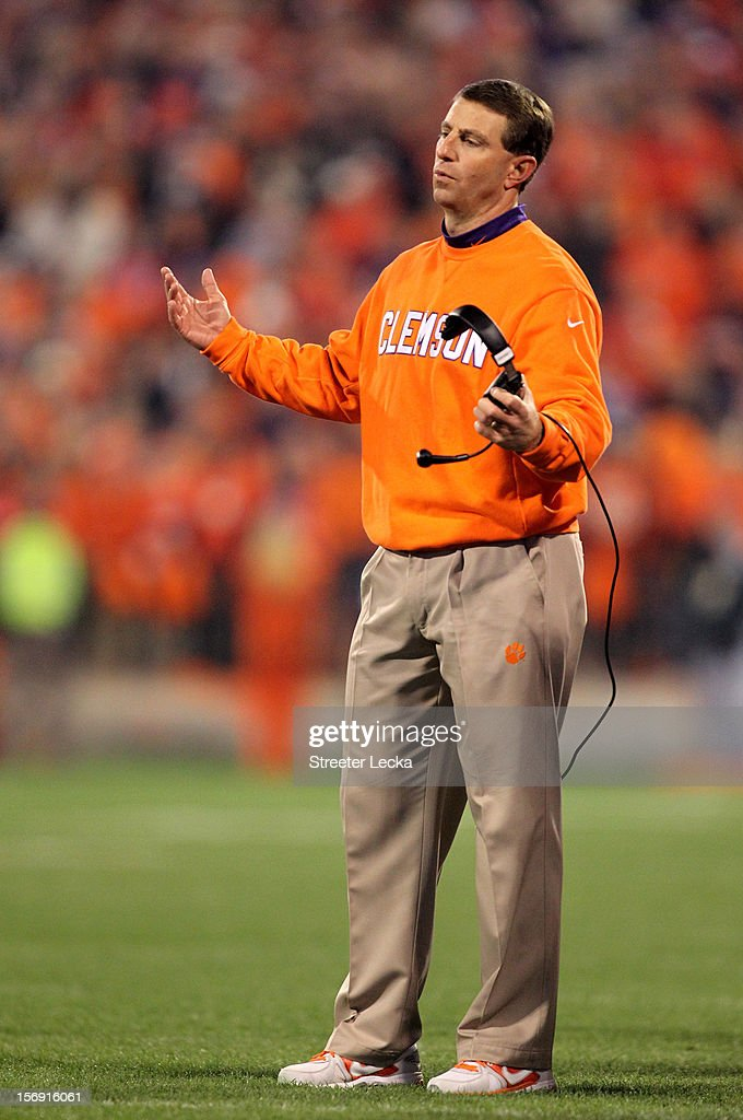 Head coach Dabo Swinney of the Clemson Tigers reacts as he watches on from the sidelines during their game against the South Carolina Gamecocks at Memorial Stadium on November 24, 2012 in Clemson, South Carolina.
