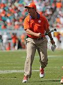 Head coach Dabo Swinney of the Clemson Tigers reacts to a play during a game against the Miami Hurricanes at Sun Life Stadium on October 24 2015 in...