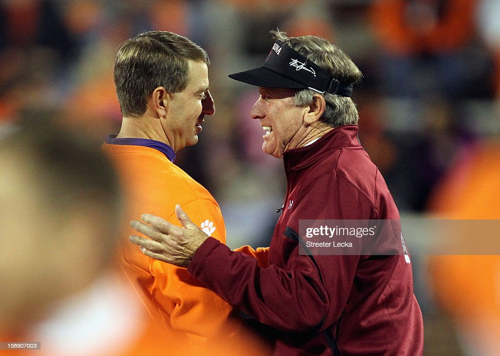 Head coach Dabo Swinney of the Clemson Tigers shakes hands with head coach Steve Spurrier of the South Carolina Gamecocks before their game at Memorial Stadium on November 24, 2012 in Clemson, South Carolina.