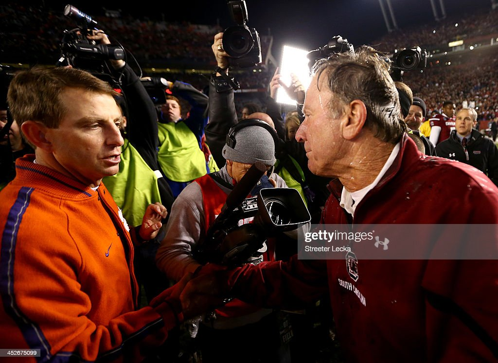 Head coach Dabo Swinney of the Clemson Tigers shakes hands with head coach <a gi-track='captionPersonalityLinkClicked' href=/galleries/search?phrase=Steve+Spurrier&family=editorial&specificpeople=228031 ng-click='$event.stopPropagation()'>Steve Spurrier</a> of the South Carolina Gamecocks after a 31-17 win for the Gamecocks at Williams-Brice Stadium on November 30, 2013 in Columbia, South Carolina.