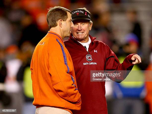 Head coach Dabo Swinney of the Clemson Tigers talks to head coach Steve Spurrier of the South Carolina Gamecocks before their game at WilliamsBrice...