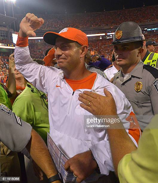 Head coach Dabo Swinney of the Clemson Tigers walks off the field after his team defeated the Louisville Cardinals at Memorial Stadium on October 1...