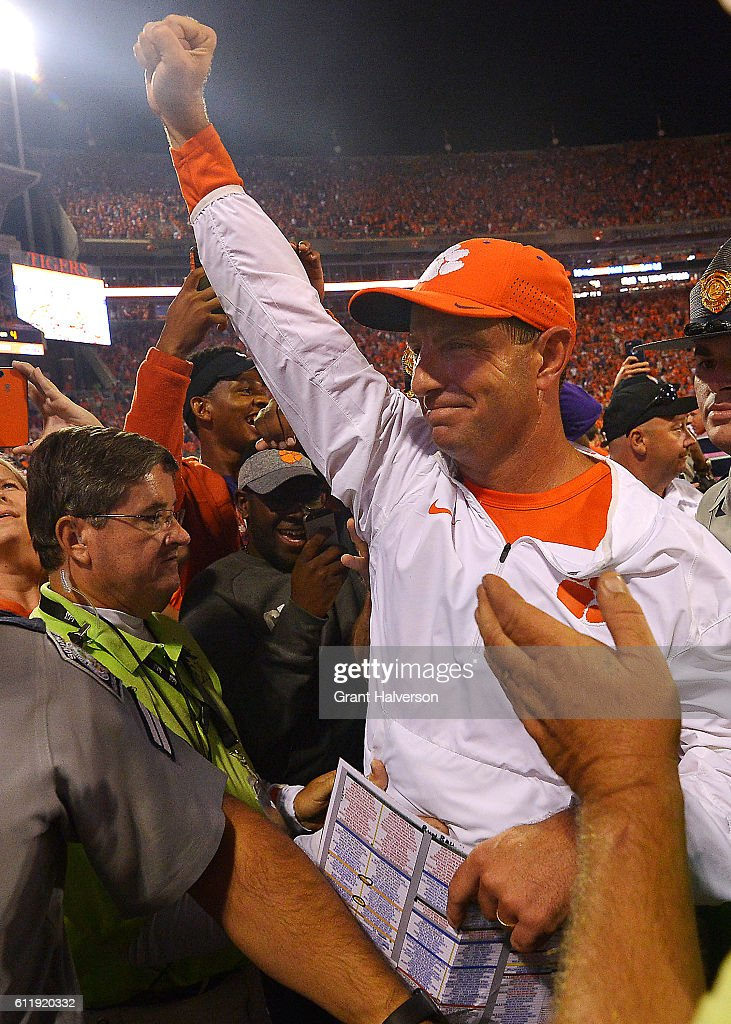 Head coach Dabo Swinney of the Clemson Tigers walks off the field after his team defeated the Louisville Cardinals at Memorial Stadium on October 1, 2016 in Clemson, South Carolina. The Clemson Tigers defeated the Louisville Cardinals 42-36.