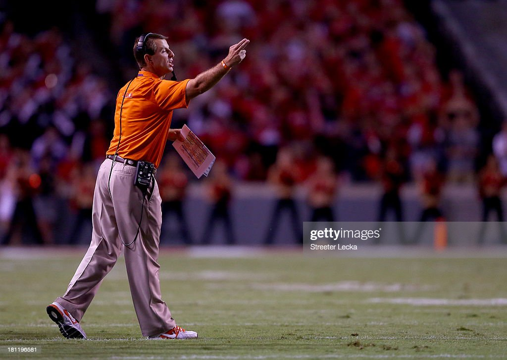 Head coach Dabo Swinney yells to his team from the sidelines against the North Carolina State Wolfpack during their game at Carter-Finley Stadium on September 19, 2013 in Raleigh, North Carolina.