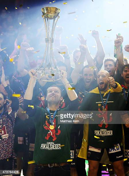 Head coach Dagur Sigurdsson and his team of Berlin celebrate with the trophy after winning the EHF Cup 2015 final match between Fuechse Berlin and...