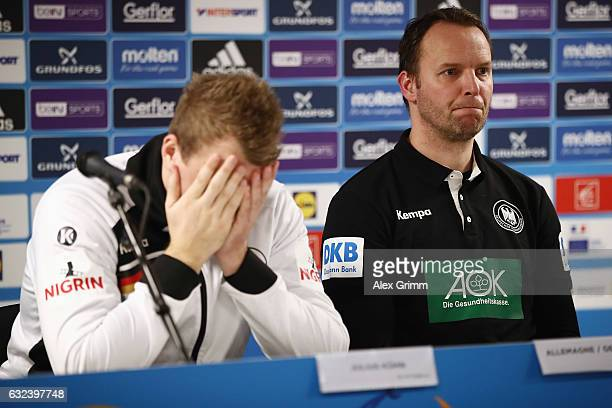 Head coach Dagur Sigurdsson and Julias Kuehn of Germany react during the press conference after the 25th IHF Men's World Championship 2017 Round of...