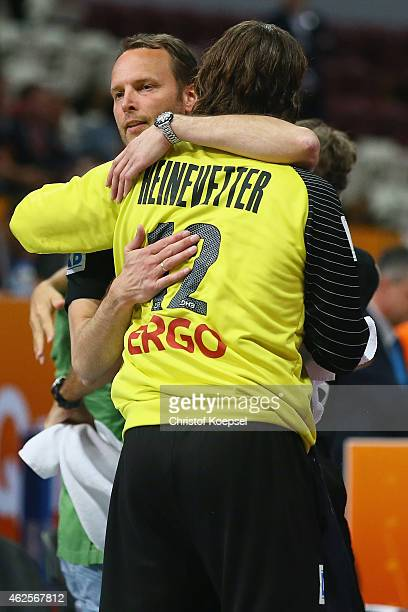 Head coach Dagur Sigurdsson embraces Silvio Heinevetter of Germany after the eighth place match between Germany and Slovenia in the Men's Handball...