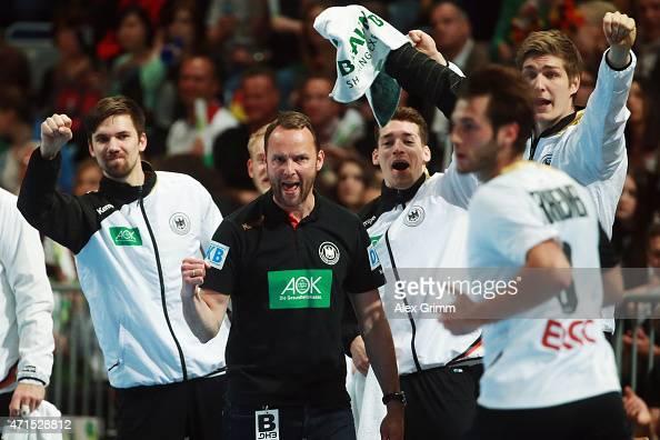 Head coach Dagur Sigurdsson of Germany celebrates a goal by Uwe Gensheimer during the European Handball Championship 2016 Qualifier match between...