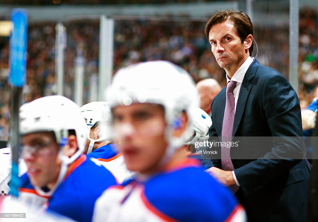 Head coach <a gi-track='captionPersonalityLinkClicked' href=/galleries/search?phrase=Dallas+Eakins&family=editorial&specificpeople=714367 ng-click='$event.stopPropagation()'>Dallas Eakins</a> of the Edmonton Oilers looks on from the bench during their NHL game against the Vancouver Canucks at Rogers Arena October 11, 2014 in Vancouver, British Columbia, Canada. Vancouver won 5-4 in a shootout.