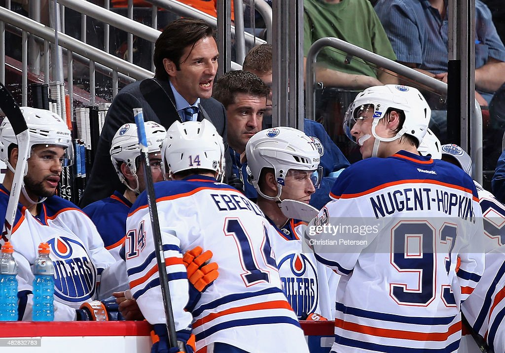 Head coach <a gi-track='captionPersonalityLinkClicked' href=/galleries/search?phrase=Dallas+Eakins&family=editorial&specificpeople=714367 ng-click='$event.stopPropagation()'>Dallas Eakins</a> of the Edmonton Oilers talks with Jordan Eberle #14 and <a gi-track='captionPersonalityLinkClicked' href=/galleries/search?phrase=Ryan+Nugent-Hopkins&family=editorial&specificpeople=7144190 ng-click='$event.stopPropagation()'>Ryan Nugent-Hopkins</a> #93 during a time out from the NHL game against the Phoenix Coyotes at Jobing.com Arena on April 4, 2014 in Glendale, Arizona. The Oilers defeated the Coyotes 3-2 in an overtime shoot-out.