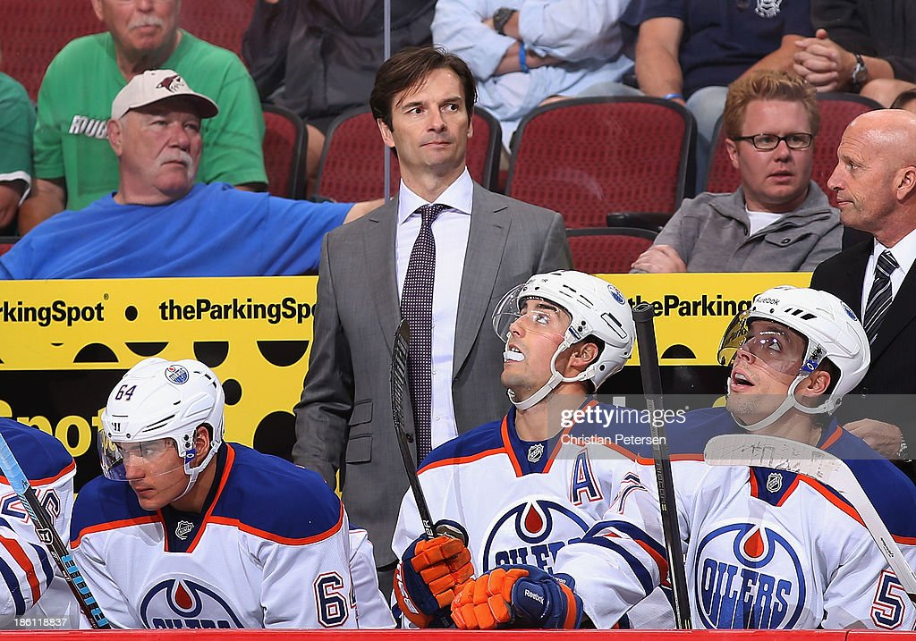 Head coach <a gi-track='captionPersonalityLinkClicked' href=/galleries/search?phrase=Dallas+Eakins&family=editorial&specificpeople=714367 ng-click='$event.stopPropagation()'>Dallas Eakins</a> of the Edmonton Oilers watches from the bench during the NHL game against the Phoenix Coyotes at Jobing.com Arena on October 26, 2013 in Glendale, Arizona. The Coyotes defeated the Oilers 5-4.