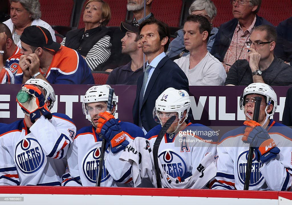 Head coach <a gi-track='captionPersonalityLinkClicked' href=/galleries/search?phrase=Dallas+Eakins&family=editorial&specificpeople=714367 ng-click='$event.stopPropagation()'>Dallas Eakins</a> of the Edmonton Oilers watches from the bench during the NHL game against the Arizona Coyotes at Gila River Arena on October 15, 2014 in Glendale, Arizona. The Coyotes defeated the Oilers 7-4.