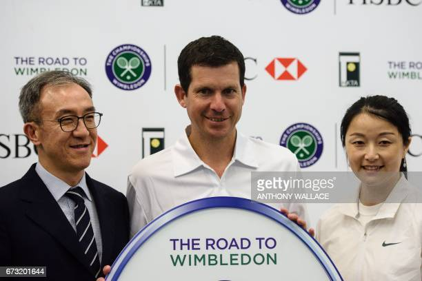 AELTC head coach Dan Bloxham former British tennis number one player Tim Henman and Chinese grand slam champion doubles tennis player Yan Zi pose...