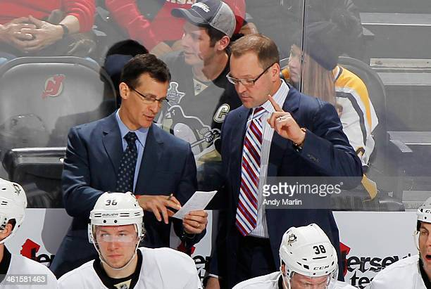Head coach Dan Bylsma and assistanst coach Tony Granato of the Pittsburgh Penguins have a discussion during action against the New Jersey Devils at...