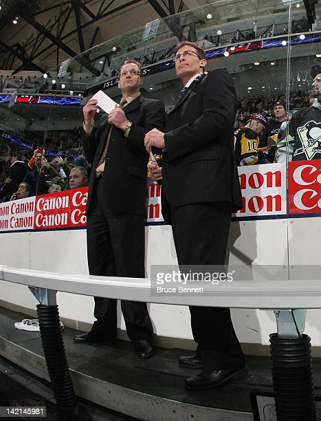 Head coach Dan Bylsma and assistant coach Tony Granato of the Pittsburgh Penguins handle bench duties against the New York Islanders at the Nassau...