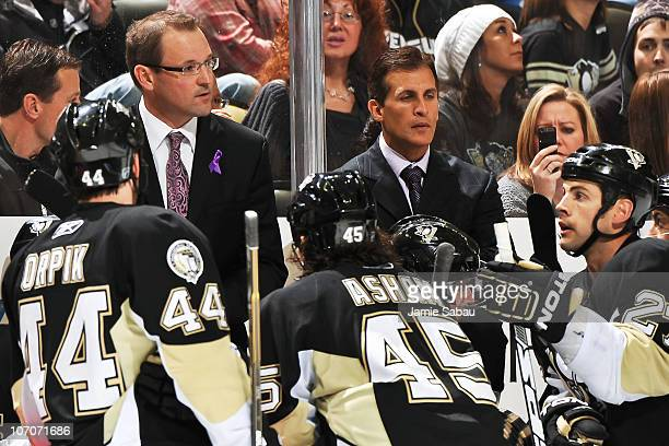 Head Coach Dan Bylsma and assistant coach Tony Granato of the Pittsburgh Penguins address the team during a timeout against the Carolina Hurricanes...
