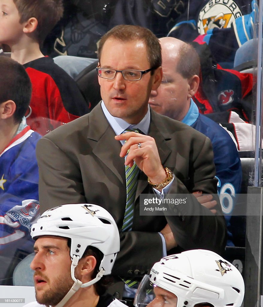 Head coach Dan Bylsma of the Pittsburgh Penguins looks on against the New Jersey Devils during the game at the Prudential Center on February 9, 2013 in Newark, New Jersey.